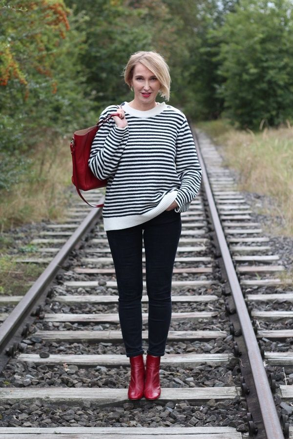 A fashion blog for women over 40 and mature women Sweater: Anine Bing Pants: Levis Booties: Zara Bag: Rochas