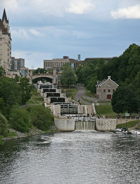 Ottawa - The Rideau Canal (built to protect Canada from the Yanks) - to the left is the Fairmont Chateau Laurier (famous hotel) and the little building on the right was the first stone building in Ottawa, now it is the Bytown Museum... holds the history of the building of the Rideau Canal by the Irish...