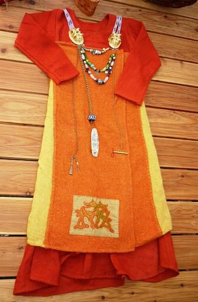 Womens costume.  I would totally rock this, if only for the extensive use of orange.