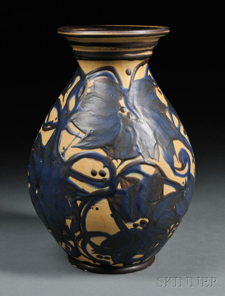 Herman Kahler Vase Art pottery Denmark Brown flared rim on swollen body with blue and brown floral decoration on a yellow-brown ground, incised HAK mark and impressed Danmark on base