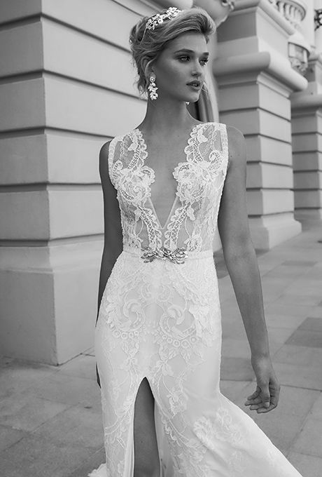 Alessandra Rinaudo Bridal Couture. Ivory sheath dress with deep V-neck cut embroidered with beaded lace.