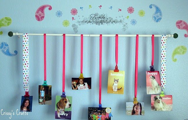 This is a cute way to hang pictures, could also be a cute way to hang art work!