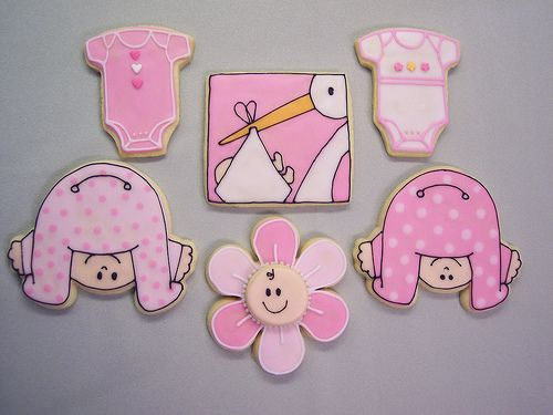 "My friend asked me to make some cookies for a baby shower at her office. I was happy to oblige! I got to try out my ""peek-a-boo"" baby cutter for the first time. The stork design is from shower invitations. I did the onesies and the baby flower cookies to offset the time involvement of the stork. I don't know which designer to thank for the flower design, but it was a fun cookie to do!"