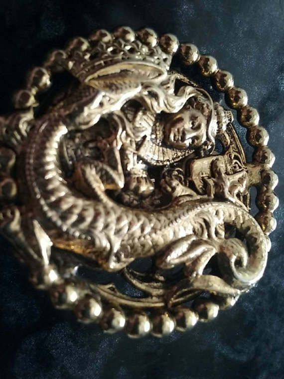 Check out this item in my Etsy shop https://www.etsy.com/au/listing/516635965/vintage-dragon-with-lady-clip-on