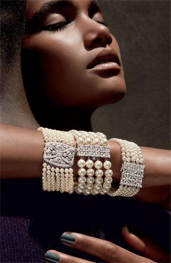 Diamond, pearl and platinum bracelets.