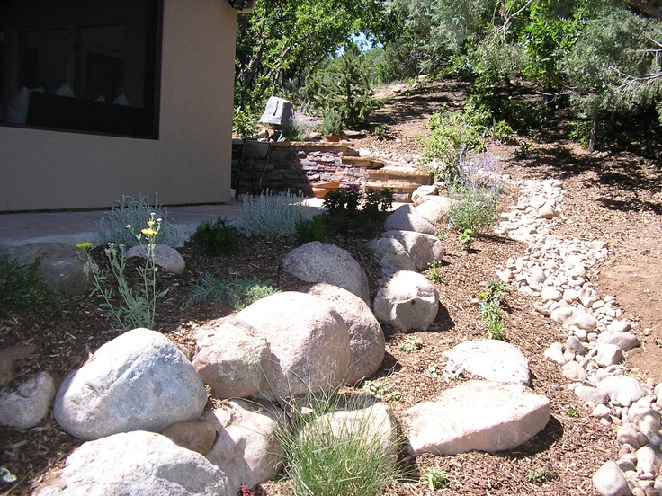 9 best images about drainage solutions with cobble for Large river rock landscaping