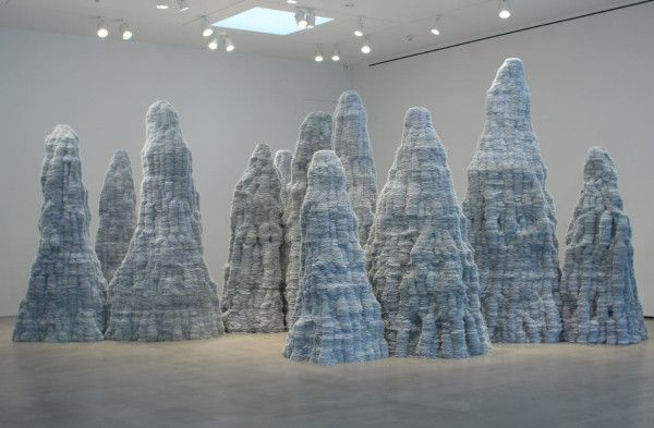 Millions Of Pieces: The Sculptures of Tara Donovan.   composed of MILLIONS of styrene index cards towers over 11 feet tall!! The cards are intermingled in two colors, a very light blue and very light green, and are thicker than standard 3×5 index cards. Each is meticulously angled, placed and glued by hand. http://design-milk.com/millions-pieces-sculptures-tara-donovan/