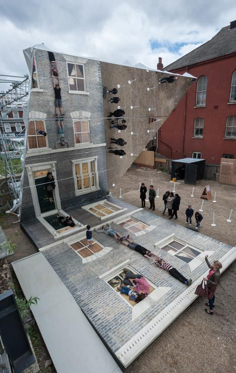 Located in Hackney, Dalston House by Leandro Erlich is a temporary installation comprising a reconstructed house facade lying face-up and a mirror positioned over it at a 45-degree angle.