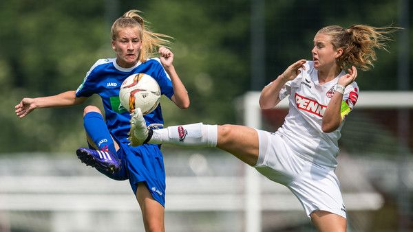 Marlene Mueller (L) of Potsdam and Ann-Kathrin Vinken (R) of Koeln fight for the ball during the B Junior Girl's German Championship Semi Final match between 1. FC Koeln and 1. FFC Turbine Potsdam on June 3, 2017 in Cologne, Germany.