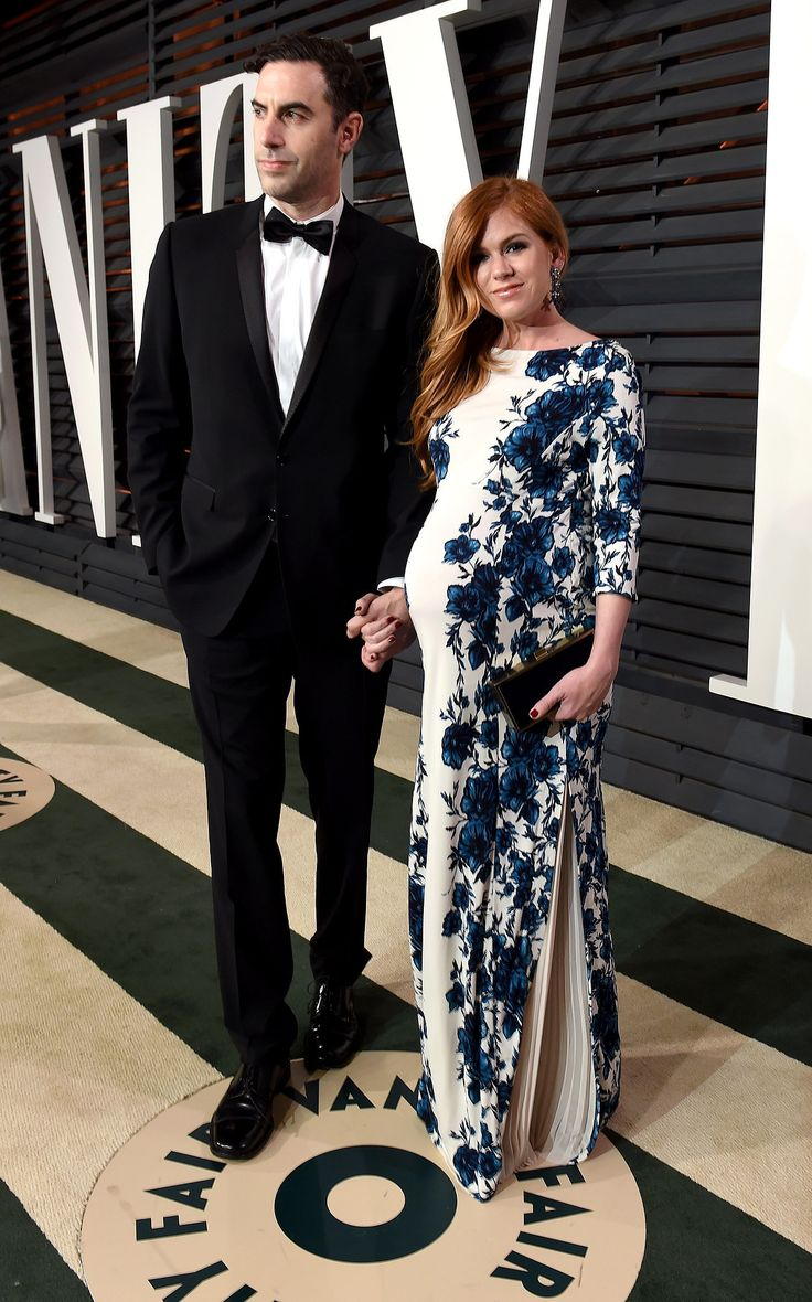 Being extremely pregnant didn't stop Isla Fisher from rocking a tight floral number to the Vanity Fair Oscars party.