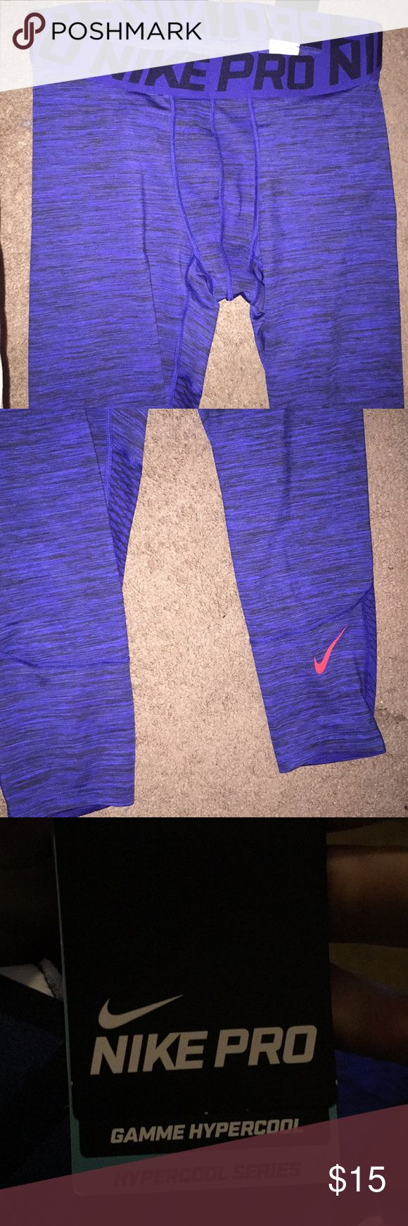Men's workout pants Great workout pants by Nike pro. Dark blue with orange swoosh. 3/4 length.   See stock photo for best color representation. Flash creates a lighter color. Nike Pants Sweatpants & Joggers