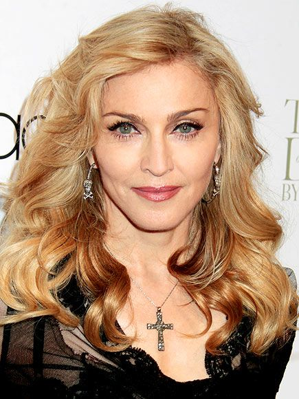 Like the softer Madge do, and the juxtaposition of the cross necklace with the scull and crossbone earrings.