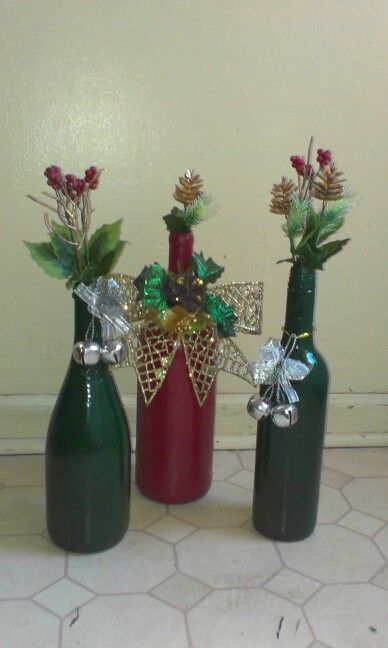Christmas decor. Spray painted wine bottles with christmas decorations from the dollar tree. Cost under $10