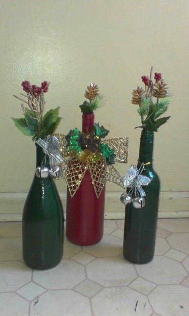 Christmas decor spray painted wine bottles with christmas for Christmas bottle decoration ideas