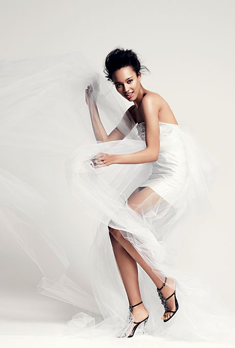 A silk and cotton short wedding dress by Anne Bowen, featuring a Swarovski-crystal embellished bodice and tulle train.
