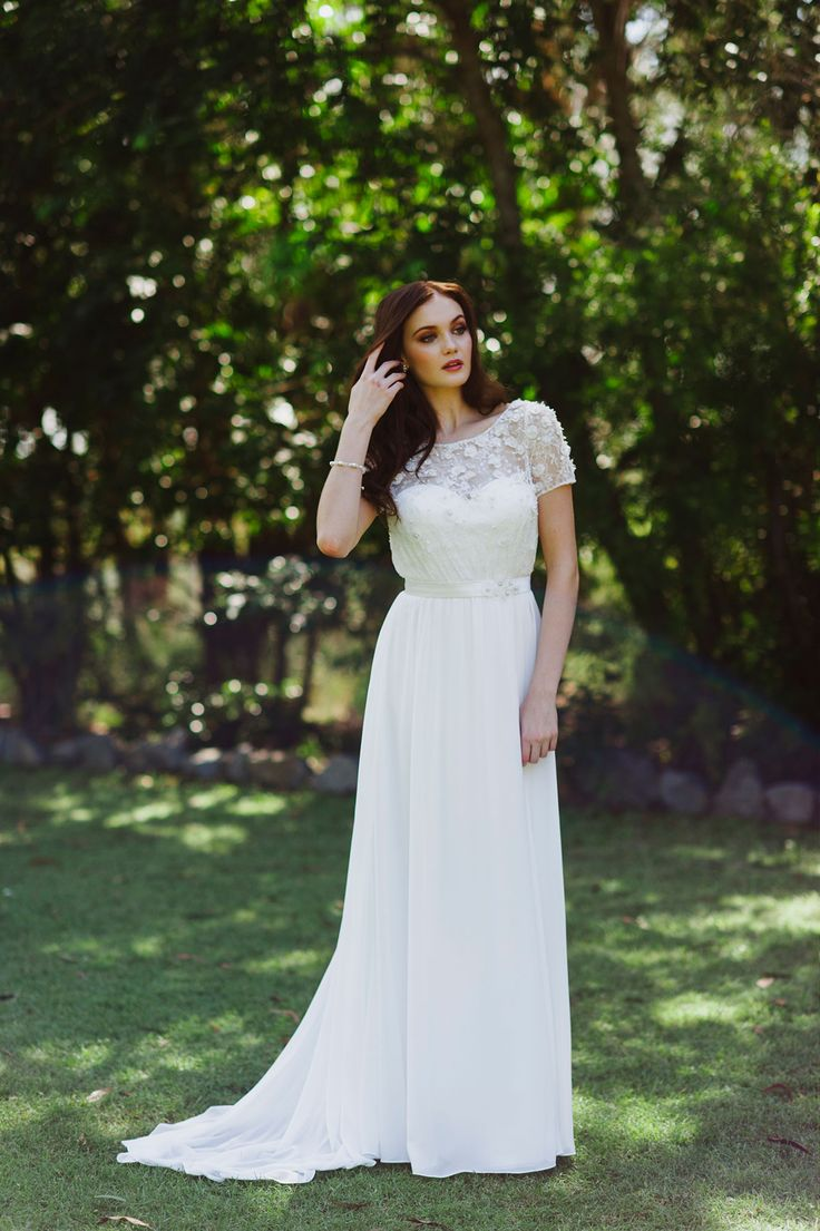 The delicate 3d flowers on Marietta gives her bodice the perfect balnce to the soft flowing skirt.