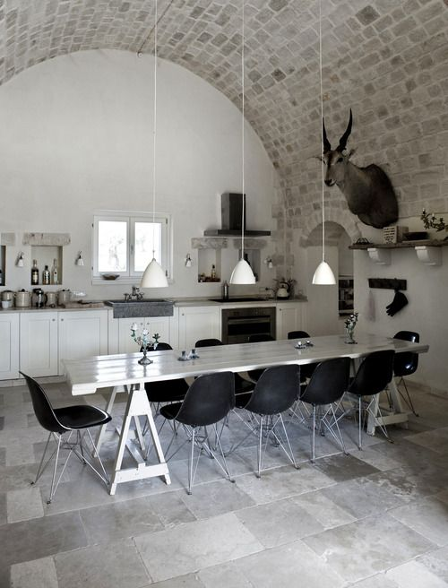Amazing Kitchen/dining Space With Arched Brick Ceiling In A Neutral  Palette. Black Eames DSR Chairs With Chrome Eiffel Legs Surround A Simple  White Table.