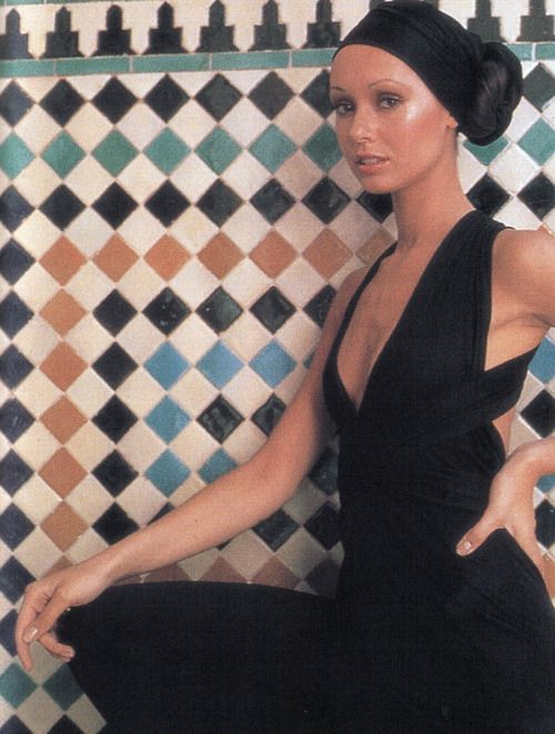 Model wearing a dress by Halston, 1970s.- (I love the wall tiles!)