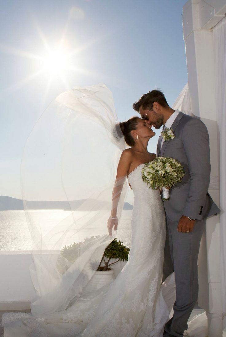 Caught in the wind! Weddings at Dana villas, Santorini Greece
