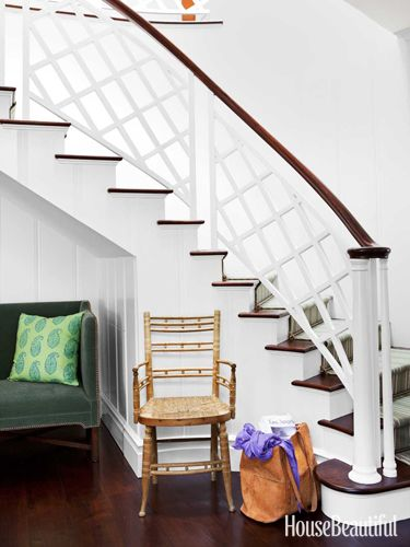 A David Hicks-inspired banister enlivens the front hall.Beach House, Beach Cottages, Unique Staircas, Dark Wood Floors, Pattern Design, Interiors Design, Home Makeovers, Under Stairs, David Hicks