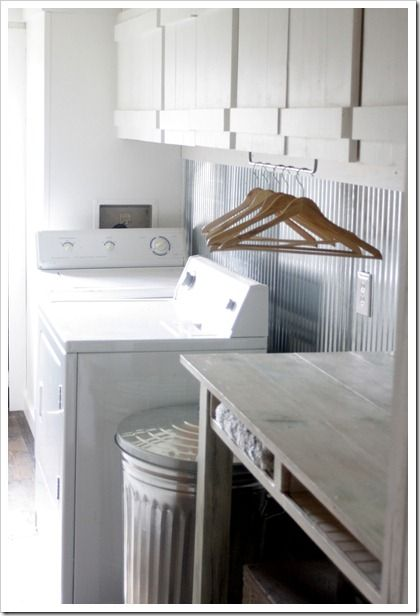 island as a folding station and corrugated metal for the backsplash