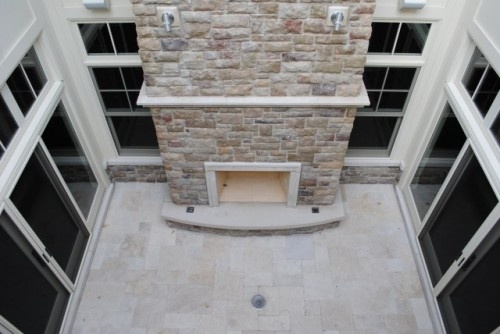 Atrium with a fireplace, dig the idea, though not this incarnation in particular
