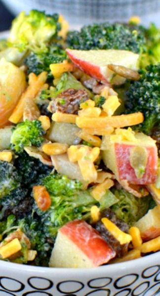 Broccoli Salad ~ Broccoli, cheese, bacon, raisins, and apples with a light dressing is a delicious and healthy option to bring for picnics and parties.