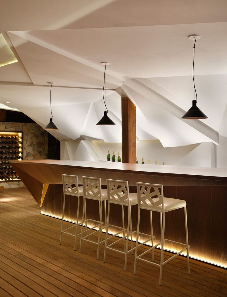 Nosotros bar avec meuble bar design et mur facett for Meuble cave a vin