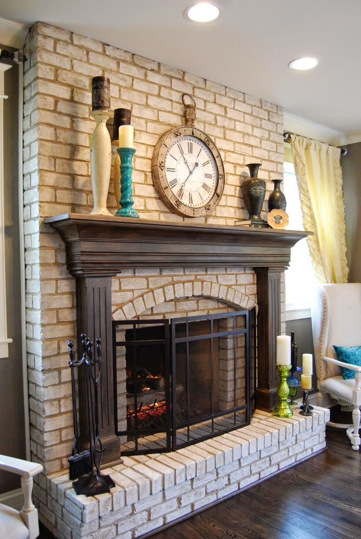 Red brick fireplace with white mantel repainted for a cozy feel LOVE eating in front of the