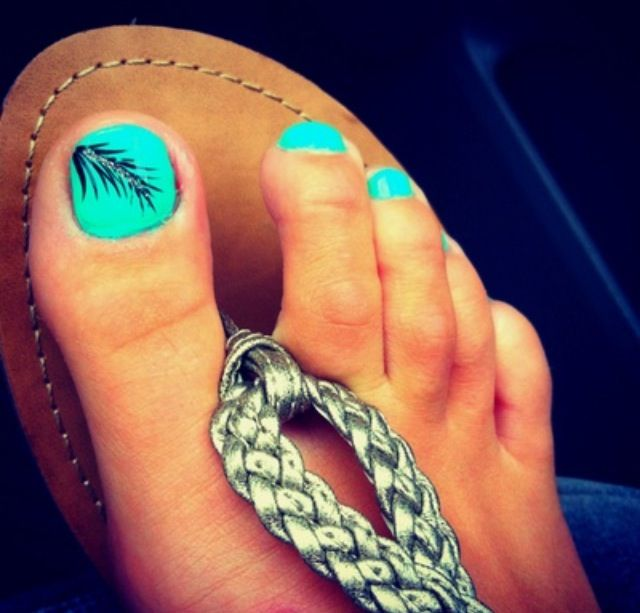 teal polish with black feather accent