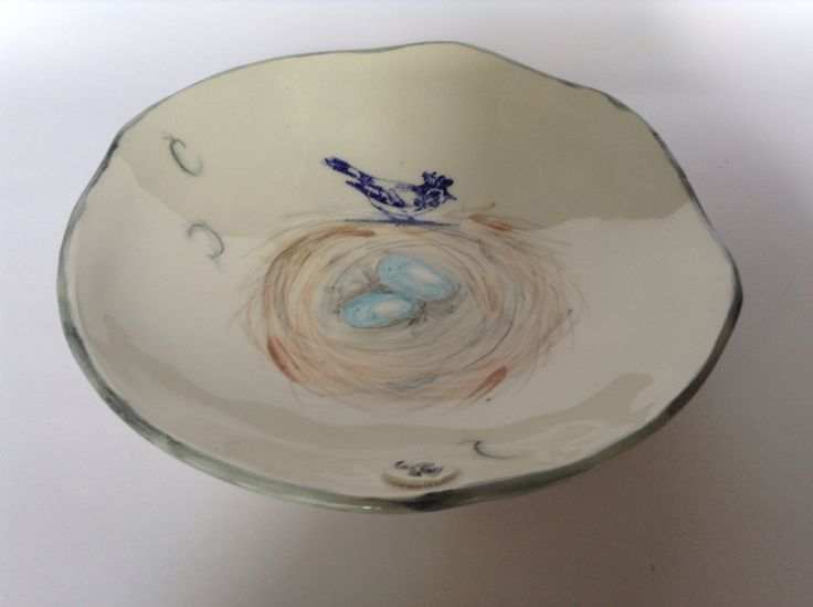 Shallow bird and nest bowl. Underglaze hand painted and stain print.