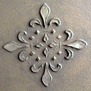 ~   Before painting your walls or ceilings, use a stencil to create a raised pattern. Holding the stencil in place, apply joint compound with a putty knife over the stencil. Remove the stencil to reveal the pattern. Allow to dry thoroughly before painting.    This could be used for the dresser drawer fronts for craft room
