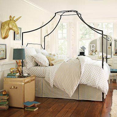 Ideally, I would love to find a wrought iron canopy bed with clean lines (much like this one), for Piper's room in the future.