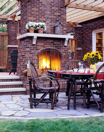 Two-Sided Outdoor Fireplace. This would be perfect for entertaining or just enjoying a beautiful evening outside with my family. I love how the fireplace serves as a sitting area and dining area....very functional and cozy.