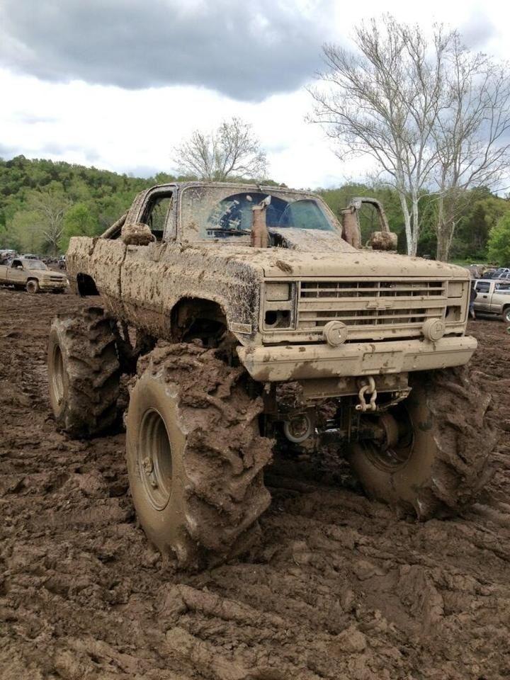 jacked up chevy trucks mudding - photo #6