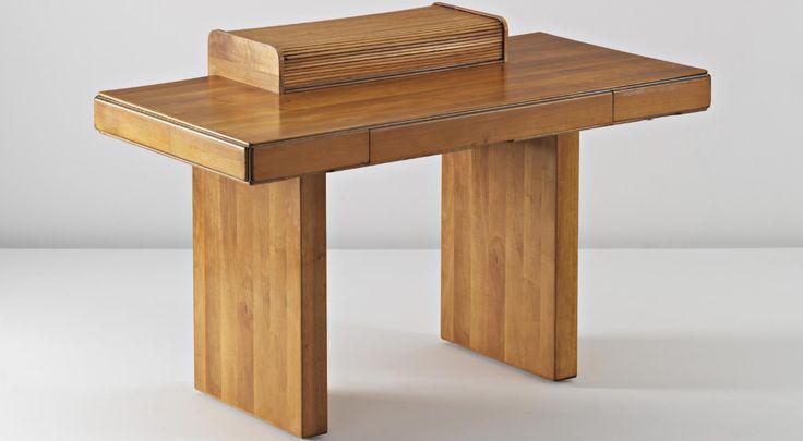 Afra and Tobia Scarpa Rare 'Torcello' desk, c. 1979 Walnut-veneered wood, metal. 85.5 x 130 x 67 cm. (33 5/8 x 51 1/8 x 26 3/8 in.) Manufactured by Stildomus, Italy. Interior of tambour storage unit impressed with 'StilDOMUS/TORCELLO/Afra e Tobia Scarpa'.