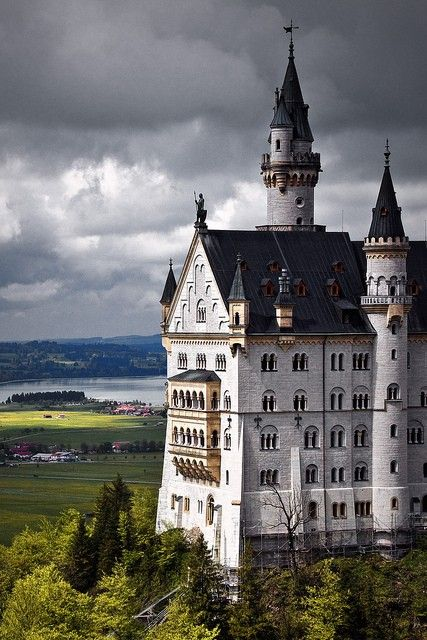 Neuschwanstein Castle is a late 19th-century Romanesque Revival palace on a rugged hill above the village of Hohenschwangau near Füssen in southwest Bavaria, Germany.  The palace has appeared prominently in several movies and was the inspiration for Disneyland's Sleeping Beauty's Castle.