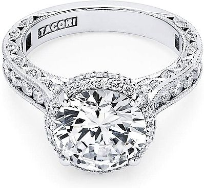 Tacori RoyalT Round Halo Diamond Engagement Ring  : A brilliant round center diamond is brought to life with stunning spotlight diamonds creating a truly royal crown for this sparkling beauty. Milligrain details decorate every inch of this Tacori engagement ring. Crescent silhouettes create a timeless and classic profile sure to please any blushing bride to be.