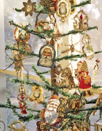 Antique paper santa ornaments adorn an antique feather tree. Barbara White has collected nearly 150 paper Santas, many with old tinsel and glitter.