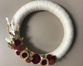 Fall yarn wreath with felt flowers