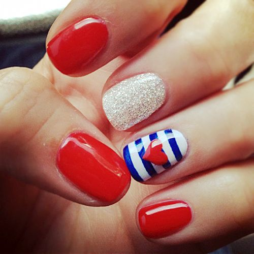 4th of July Nail Art - I would do all red with the one striped/heart.  So cute!