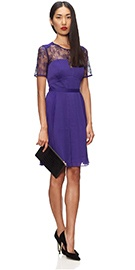 The latest update of our bestselling clara dress, this little purple number will be your go-to piece over the Christmas party period. With delicate lace panels and a pleated skirt keep your accessories simple for an elegant evening look. 100% Polyester. Model wears a size 10. Length from side neck to hem 96cm.