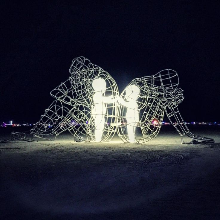 At Burning Man 2015. Photo by Emily Rosen: This. Two adults back to back while their inner child reach for each other. Stopped me in my tracks while biking around the playa my last night at Burning…