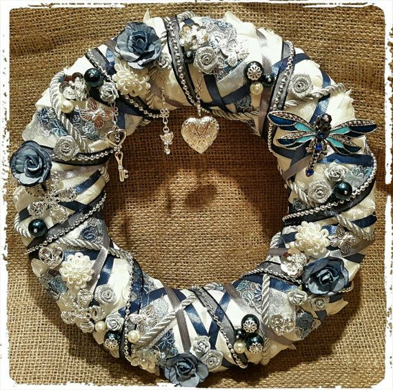 Check out this item in my Etsy shop https://www.etsy.com/uk/listing/479940666/blue-and-silver-wreath-with-flowers