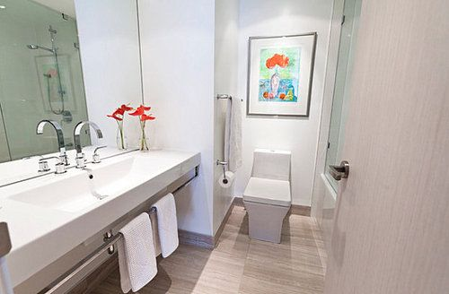 Fabulous Vibrant Orange In A Minimalist Bathroom Installed On Sleek Wooden Floor Completed White Countertop And Faucet #bathroom decorating tips, vanity table, luxurious furniture decorating tips cheap