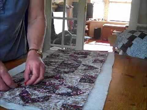 this is a GREAT QAYG tutorial - done in rows, so very manageable sizes without joining individual blocks  NO SASHING!