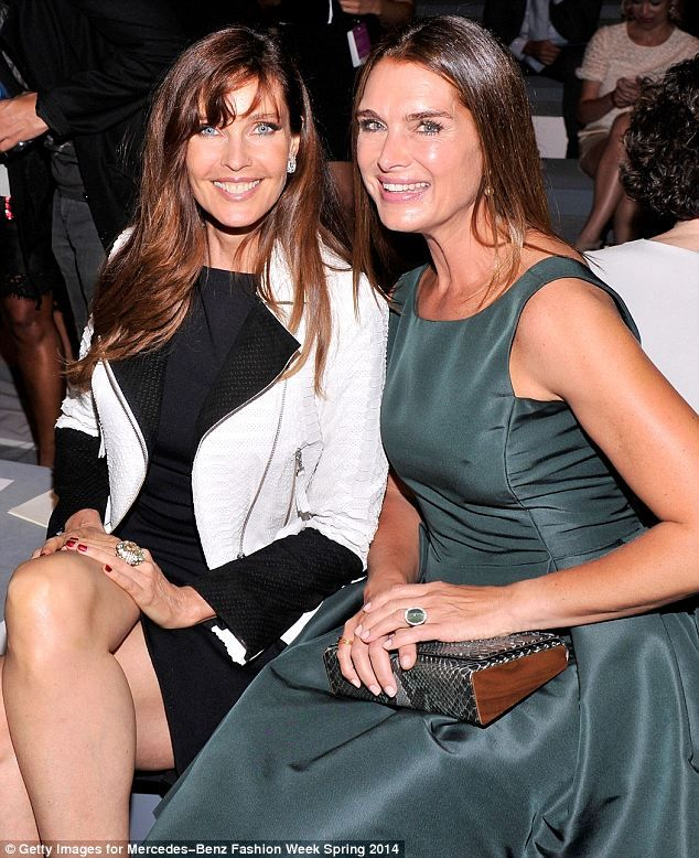 They must be used to this by now! Models and former colleagues Carol Alt (L) and…