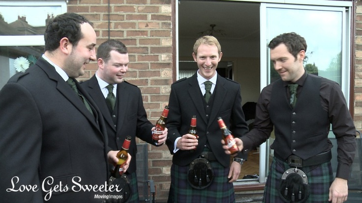 Groom enjoying a beer with his best man and ushers in their kilts