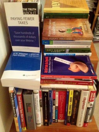 A pro-paper group says the increasingly digital IRS also needs to accommodate taxpayers who can't or don't want to go electronic. (Some of my actual tax and personal finance books)