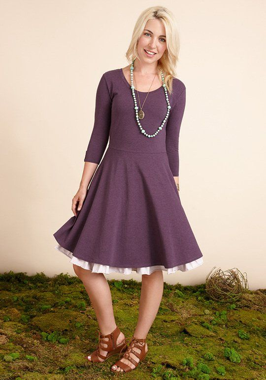 Queen of Hearts Dress  The Queen of Hearts Dress is made with a saturated purple knit and accented with a darling lavender ruffle under the hem. This beautiful dress can be easily dressed up with a fabulous necklace and your favorite heels!  Size adult Item #: 22608D $68.00